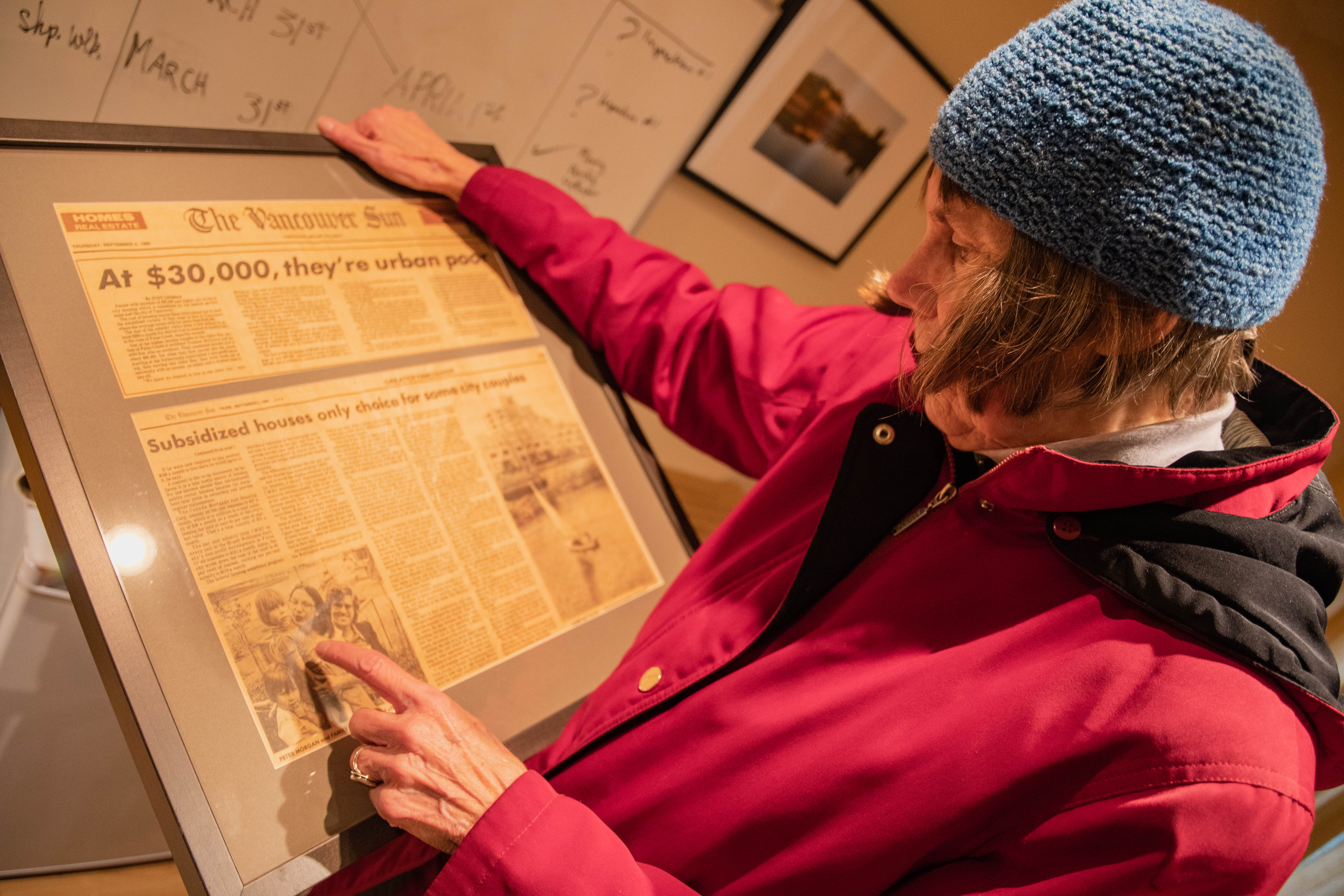 Nancy with a 1960's newspaper article which portrays the co-op in a negative light